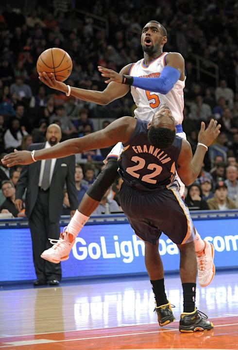 New York Knicks' Tim Hardaway Jr. (5) runs into Memphis Grizzlies' Jamaal Franklin (22) during the second quarter of an NBA basketball game Saturday, Dec. 21, 2013, at Madison Square Garden in