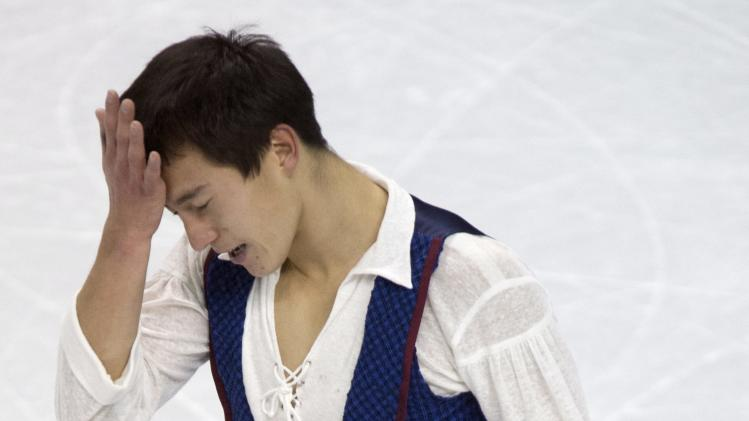 Patrick Chan of Canada ,reacts after his free skate program in the men's competition at the World Figure Skating Championships Friday, March 15, 2013 in London, Ontario. AP Photo/The Canadian Press, Frank Gunn)