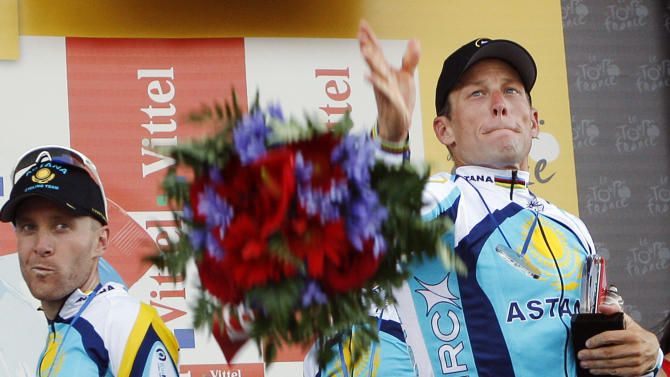 FILE - In this July 7, 2009, file photo, Lance Armstrong, right, and Levi Leipheimer, left, both of the United States, celebrate on the podium after winning the fourth stage of the Tour de France cycling race, a team time-trial with start and finish in Montpellier, southern France. In 2009, Armstrong unretired from cycling and finished third. Leipheimer later confessed to doping as part of the investigation that brought down Armstrong. After a decade of denial and being stripped of his titles, Armstrong said during an interview with Oprah Winfrey taped Monday, Jan. 14, 2013, that he used performance-enhancing drugs to win the Tour de France, a person familiar with the situation told The Associated Press. (AP Photo/Christophe Ena, File)