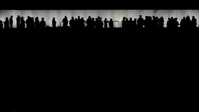 In this Sept. 10, 2011 photo, people gather at the Wall of Names during a vigil at Phase 1 of the permanent Flight 93 National Memorial  near the crash site of United Flight 93 in Shanksville, Pa. More and more people are visiting the Flight 93 National Memorial in rural western Pennsylvania, authorities say, and new construction is scheduled to begin next year. (AP Photo/Amy Sancetta)