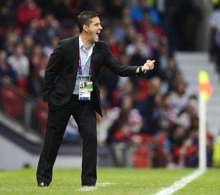 Canadian coach John Herdman yells to his team playing the USA in the women's semi final soccer match at the London 2012 Olympic Games at Old Trafford in Manchester