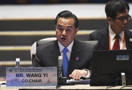 China's Foreign Minister Wang Yi speaks at the start of Asia-Pacific Economic Cooperation (APEC) Summit ministerial meetings at the China National Convention Centre (CNCC) in Beijing