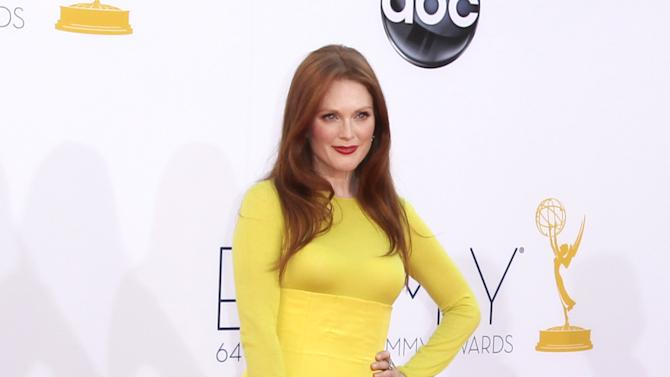 FILE - This Sept. 23, 2012 file photo shows actress Julianne Moore at the 64th Primetime Emmy Awards at the Nokia Theatre in Los Angeles. Moore's neon-yellow Dior Haute Couture outfit (really a sweater and ball skirt) spawned a love-it-or-hate-it debate among armchair style critics.  (Photo by Matt Sayles/Invision/AP, file)