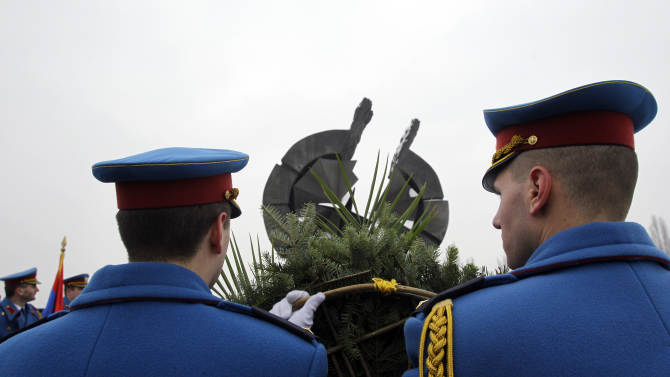 Serbian military honor guard attend commemorations for victims of the Holocaust at a monument erected in the former World War II Nazi concentration camp of Sajmiste in Belgrade, Serbia, Sunday, Jan. 27, 2013. The ceremony coincided with International Holocaust Remembrance Day, which marks the liberation of the Auschwitz Nazi concentration camp on Jan. 27, 1945. (AP Photo/Darko Vojinovic)