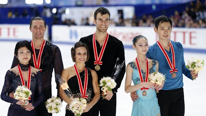 Winners Meagan Duhamel and Eric Radford of Canada, center, second-placed Yuko Kavaguti and Alexander Smirnov of Russia, left, and third-placed Yu Xiaoyu and Jin Yang of China pose for photographers during awarding ceremony of the pairs skating of the NHK Trophy figure skating in Osaka, western Japan, Saturday, Nov. 29, 2014. (AP Photo/Shizuo Kambayashi)