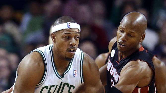 FILE - In this Jan. 27, 2013, file photo, Boston Celtics forward Paul Pierce, left, tries to keep the ball from Miami Heat guard Ray Allen during the first half of an NBA basketball game in Boston. The Celtics won 100-98 in double overtime. Winners of 20 games in a row, the Heat could be headed toward history. The Celtics, who host the Heat on March 18, are one team looking for their opportunity to stop the streak. (AP Photo/Steven Senne, File)