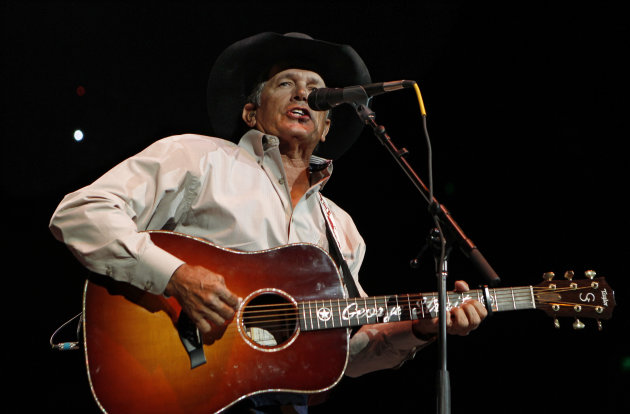 FILE - In this Oct. 17, 2011 file photo, George Strait performs during the Fire Relief, The Concert For Central Texas, at the Frank Erwin Center in Austin, Texas. The 60-year-old country music superstar on Wednesday, Sept. 26, 2012 announced that he'll embark on his final concert tour early next year. He made the announcement at a news conference at the Country Music Hall of Fame &amp; Museum in Nashville, Tenn. (AP Photo/Erich Schlegel, File)