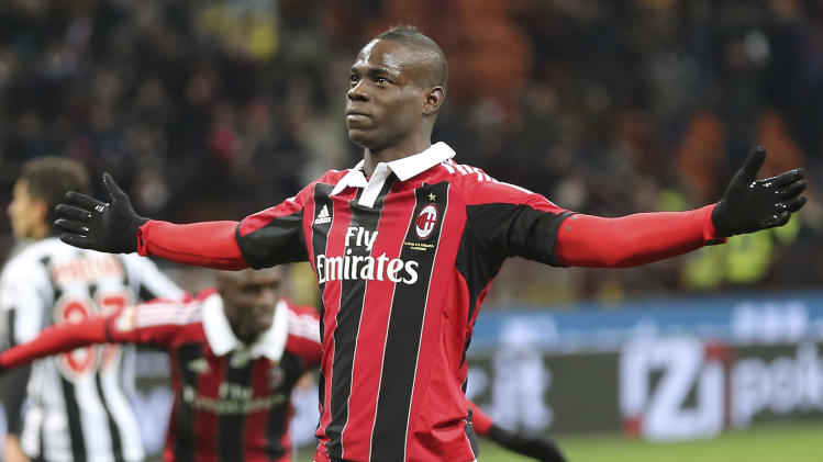 AC Milan forward Mario Balotelli celebrates after scoring during the Serie A soccer match between AC Milan and Udinese at the San Siro stadium in Milan, Italy, Sunday, Feb. 3, 2013. (AP Photo/Antonio Calanni)