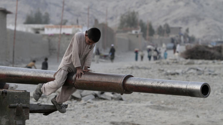An Afghan child plays on the barrel of a Soviet tank in the Behsood district of Jalalabad, Afghanistan, Monday, Feb 18, 2013. Despite being a mineral-rich country, four decades of war have left Afghanistan as one of the least developed countries in the world and highly dependent on foreign aid. (AP Photo/Rahmat Gul)