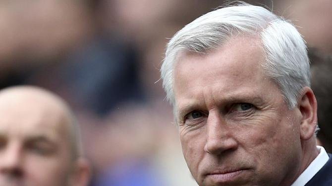 This is a Feb. 23, 2014  file photo of Newcastle United's manager Alan Pardew as he looks on ahead of their English Premier League soccer match against Aston Villa at St James' Park, Newcastle, England. The new English Premier League season starts on Saturday Aug. 16, 2014