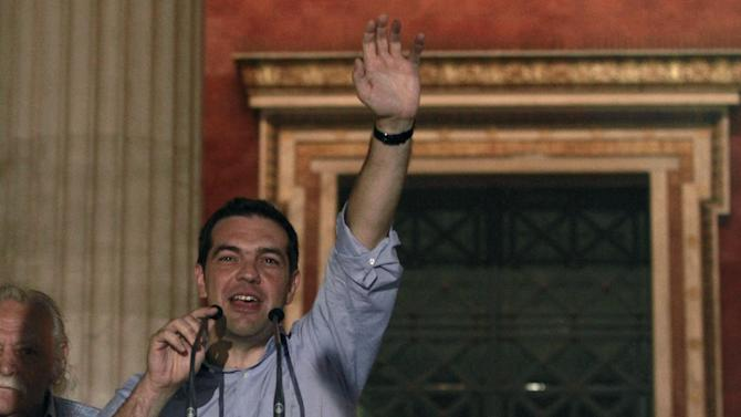 Radical Left party (SYRIZA) leader Alexis Tsipras waves to his supporters  in front of Athens' university, Sunday, June 17, 2012. Alexis Tsipras and his party shot to prominence in the May 6 vote, where he came a surprise second and quadrupled his support since the 2009 election. Syriza party has vowed to rip up Greece's bailout agreements and repeal the austerity measures, which have included deep spending cuts on everything from health care to education and infrastructure, as well as tax hikes and reductions of salaries and pensions.(AP Photo/Petros Karadjias)