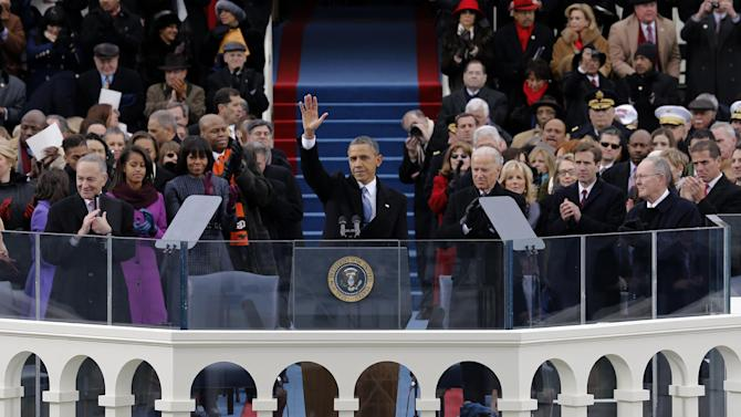 FILE - In this Jan. 21, 2013, photo, President Barack Obama waves to crowd after his inaugural speech at the ceremonial swearing-in on the West Front of the U.S. Capitol during the 57th Presidential Inauguration in Washington. Gay rights advocates are renewing their push for President Barack Obama to sign an executive order banning federal contractors from discriminating against gay employees. The drive comes as Obama included an unexpected declaration of support for gay rights in the speech.  (AP Photo/Scott Andrews, Pool)