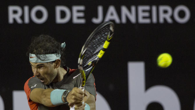 Rafael Nadal, of Spain, returns the ball to Pablo Andujar, of Spain, during a semifinal match at the Rio Open tennis tournament in Rio de Janeiro, Brazil, Saturday, Feb. 22, 2014. (AP Photo/Leo Correa)