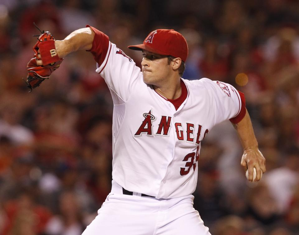 Los Angeles Angels' pitcher C.J. Wilson delivers in the second inning of a baseball game against the Tampa Bay Rays in Anaheim, Calif.,  Saturday, Aug. 18, 2012. (AP Photo/Christine Cotter)