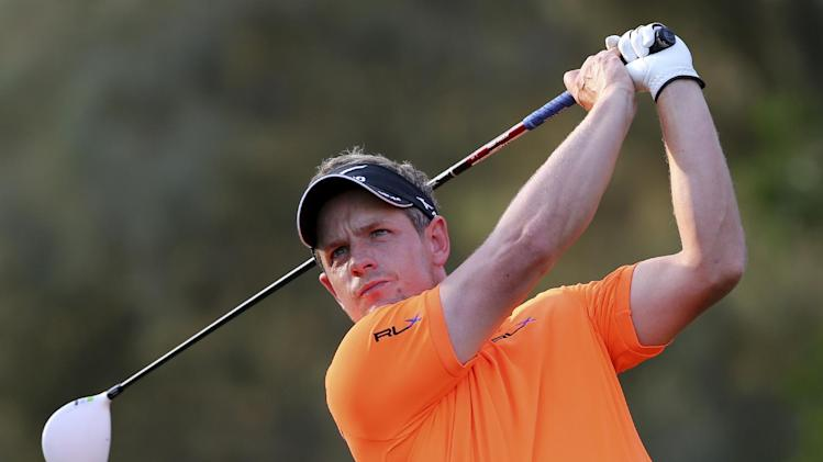 Luke Donald of England tees off on the 16th hole during the round three of DP World Golf Championship in Dubai, United Arab Emirates, Saturday, Nov. 24, 2012. (AP Photo/Kamran Jebreili)