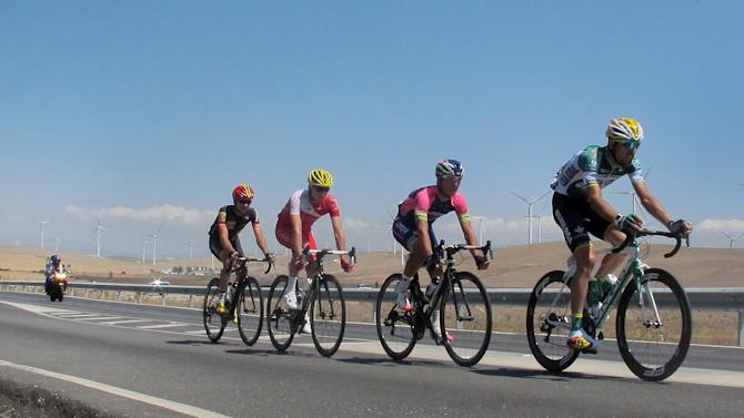 Spain's Francisco Javier Aramendia, right, leads a breakaway outside Zahara de los Atunes, Spain, during the second stage of the Vuelta, tour of Spain cycle race Sunday Aug. 24, 2014. (AP Photo/Tony Hicks)