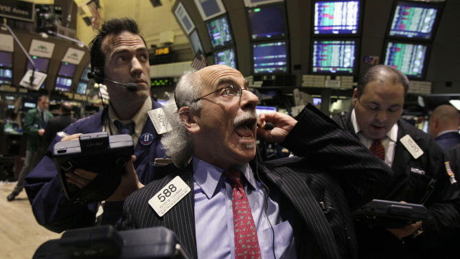 Trader Peter Tuchman, center, works on the floor of the New York Stock Exchange Tuesday, March 13, 2012. The Dow Jones industrial average rose 218 points and closed at its highest level since the end of 2007. (AP Photo/Richard Drew)