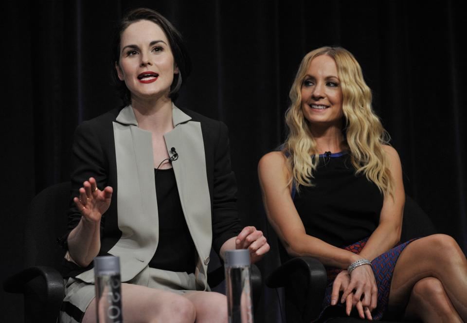 "Michelle Dockery, left, a cast member in the Masterpiece series ""Downton Abbey,"" addresses a reporter as fellow cast member Joanne Froggatt looks on at the PBS Summer 2013 TCA press tour at the Beverly Hilton Hotel on Tuesday, Aug. 6, 2013 in Beverly Hills, Calif. (Photo by Chris Pizzello/Invision/AP)"