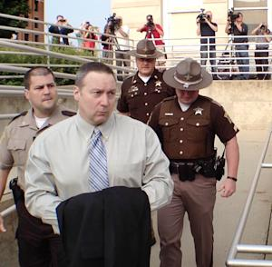 In this Thursday, Aug. 22, 2013, file photo, former Indiana State Police trooper David Camm, second left, arrives at the Boone County Courthouse in Lebanon, Ind., for his trial for the September 2000 murders of his wife and children. Jurors in Boone County on Thursday, Oct. 24, 2013 cleared Camm in the Sept. 28, 2000, deaths of 35-year-old Kimberly Camm and their children, 7-year-old Brad and 5-year-old Jill. All three were found fatally shot in the garage of the family's home in the southern Indiana community of Georgetown. The deaths occurred about four months after Camm had resigned from the Indiana State Police force to take a job with his uncle. (AP Photo/The Indianapolis Star, Charlie Nye, File) NO SALES