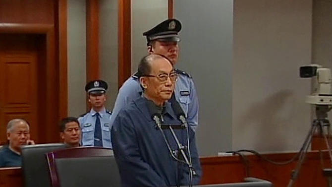 In this image made from China Central Television video, former Chinese Railways Minister Liu Zhijun stands trial at a courtroom in Beijing No. 2 Intermediate People's Court in Beijing Sunday, June 9, 2013. Liu admitted his guilt and sought leniency Sunday at his trial on corruption charges, one of the country's highest-level graft cases in years. Liu, 60, who oversaw Railways Ministry's high-profile bullet train development, has been accused of taking massive bribes and steering lucrative projects to associates. The case is seen as an indicator of how top-level officials might fare in an anti-corruption campaign that Chinese leader Xi Jinping has vowed will target both high and low officials. (AP Photo/CCTV via AP Video) CHINA OUT, TV OUT