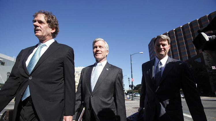 "Former Virginia Governor Bob McDonnell, center, flanked by lawyers Henry W. ""Hank"" Asbill, left, and John L. Brownlee, right, heads to the Federal Courthouse in Richmond, Va. for the start of his trial Monday, July 28, 2014. Bob and Maureen McDonnell are charged in a 14-count indictment with accepting more than $165,000 in gifts and loans from the CEO of a dietary supplements company in exchange for helping promote his products. (AP Photo/Richmond Times-Dispatch, James Wallace)"