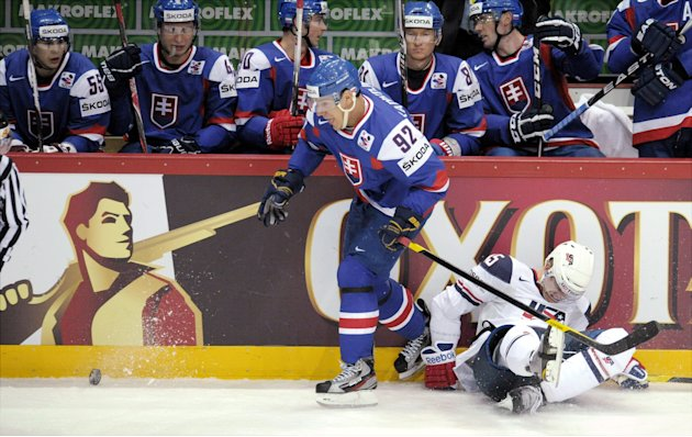 Slovakia's Branko Radivojevic tackles USA's Joey Crabb, right, during their Group H game USA vs Slovakia of the 2012 IIHF Ice Hockey World Championships in Helsinki, Finland on Monday, May 7, 2012. (A