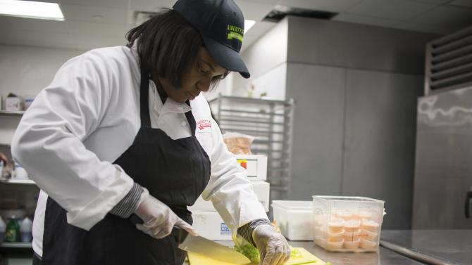 Handout photo of a student preparing food in Liberty's Kitchen in New Orleans