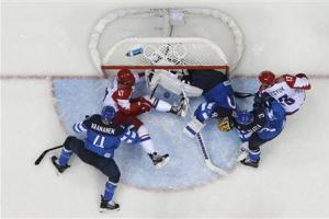 Russia's Radulov tries to push the puck into the goal as Finland's goalie Rask defends during the third period of their men's quarter-finals ice hockey game at the Sochi 2014 Winter Olympic Games