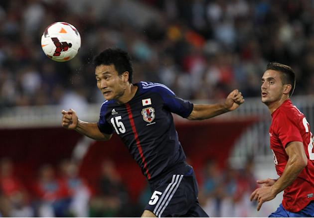 Japan's Yasuyuki Konno, left, heads the ball away from Serbia's Dusan Tadic, right, during Serbian retired soccer player Dejan Stankovic's farewell match, at Karadjordje stadium in Novi Sad, Serbia, F