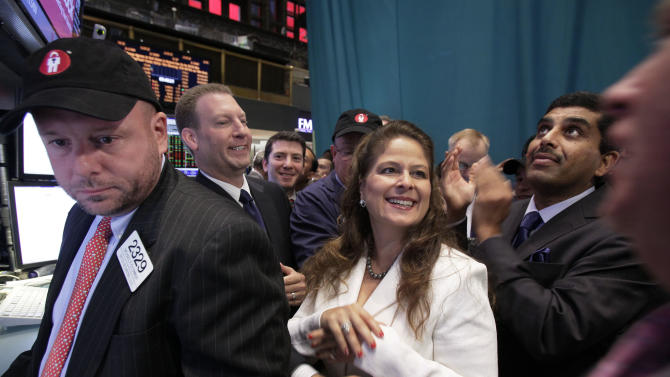 LifeLock Chairman and CEO Todd Davis, second left, is congratulated as his company's stock begins trading on the floor of the New York Stock Exchange Wednesday, Oct. 3, 2012. Joining in the occasion are company General Counsel Clarissa Cerda, center, and Chief Product Officer Prakash Ramamurthy, second from right. (AP Photo/Richard Drew)