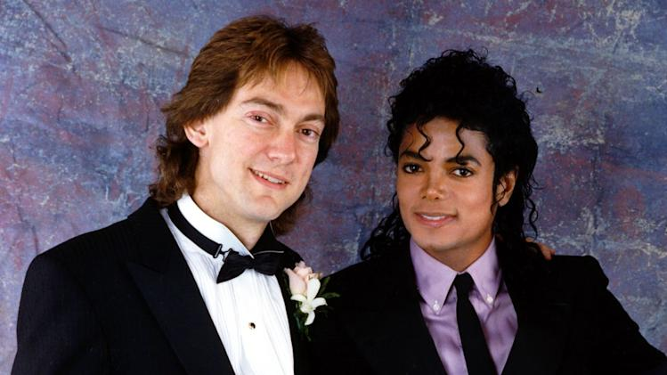 FILE - In this 1987 file photo originally released by John Branca, attorney John Branca, left, and Michael Jackson are shown at Branca's wedding in Beverly Hills, Calif.  Branca, and his co-executor, John McClain, have been successfully pursuing projects to pay off a mountain of debt left by the superstar, to assure the financial future of his three children and to guarantee that Jackson's music will live forever. (AP Photo/ Courtesy of John Branca, File) ** NO SALES **