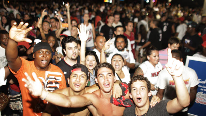 Miami Heat fans celebrate the Championship after the Heat's win against the San Antonio Spurs after the Game 7 of the NBA final basketball series in Miami on Friday, June 21, 2013.. The Heat beat the San Antonio Spurs 88-95. (AP Photo/Javier Galeano)