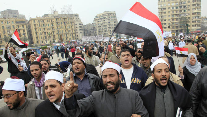 FILE - In this Monday, Feb. 7, 2011 file photo, Egyptian anti-government protester sheiks of al Azhar, the highest Islamic sunni institute, march in Tahrir Square in Cairo, Egypt. This week, as Egyptians prepare to mark on Friday the anniversary of the start of the revolution that swept aside Hosni Mubarak, the issue seems to come up at every panel that even tangentially touches on politics or strategy. The uprisings that first began in Tunisia in December 2010 did bring down dictators in Tunisia, Yemen, Libya and Egypt. But now Islamists and liberals wrangle over power, with the former mostly on top, democracy is far from certain, and economies are crumbling. (AP Photo/Amr Nabil, File)