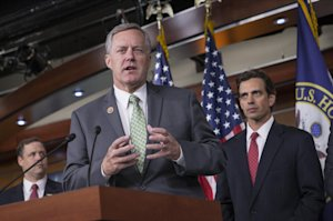 Rep. Mark Meadows, R-N.C, center, Rep. Tom Graves, …