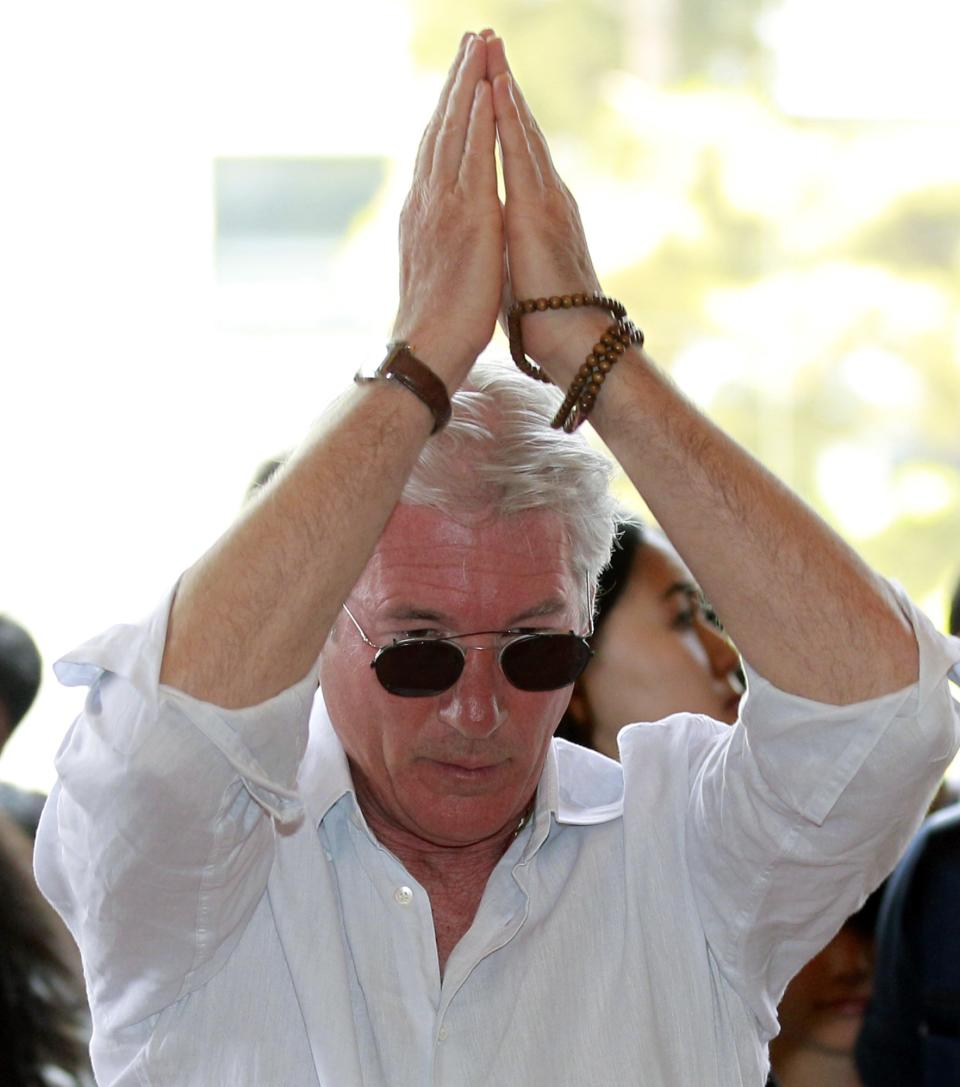 U.S. actor Richard Gere tries to bow during his visit to the Korean Buddhism's Chogye temple in Seoul, South Korea, Tuesday, June 21, 2011. Gere is in South Korea for six days to promote his photo exhibition and tour Buddhist temples. (AP Photo/ Lee Jin-man, Pool)