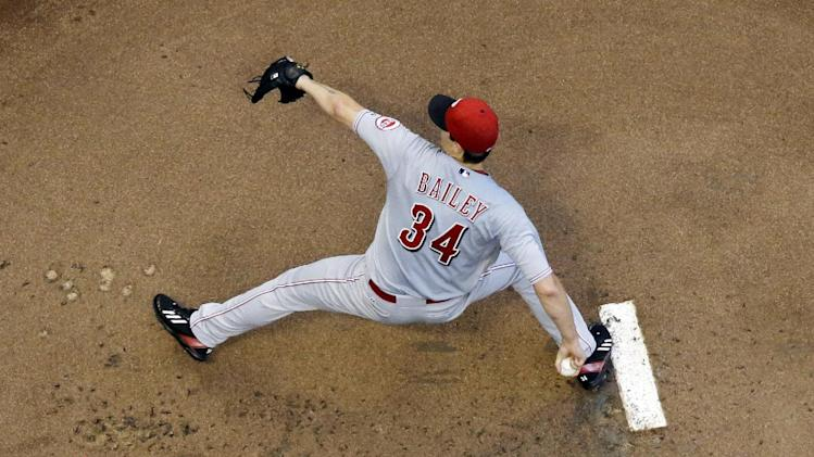 Cincinnati Reds starting pitcher Homer Bailey throws during the first inning of a baseball game against the Milwaukee Brewers, Tuesday, July 22, 2014, in Milwaukee. (AP Photo/Morry Gash)