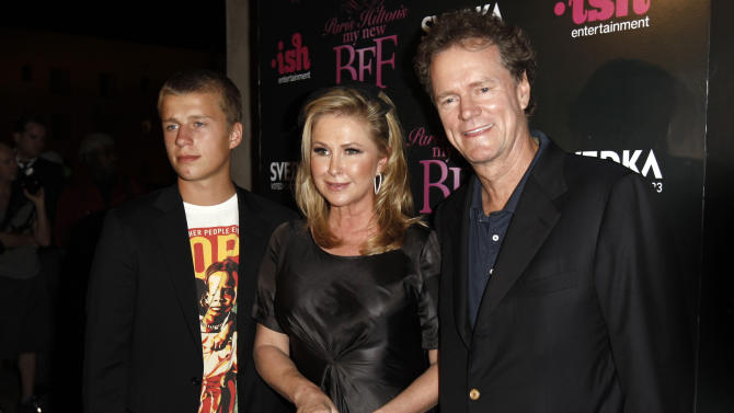"""FILE - In this Sept. 30, 2008 file photo, Conrad Hilton, left, Kathy Hilton, center, and Rick Hilton arrive at the launch party of new MTV series """"Paris Hilton's My New BFF"""" in Los Angeles. Conrad Hilton received """"major injuries"""" when he lost control of his BMW and crashed on a highway near Palm Springs. California Highway Patrol Sgt. Daniel Hesser said Tuesday, Aug. 26, 2014, that Paris Hilton's 19-year-old brother was taken from the accident scene to Desert Regional Medical Center. His current condition is unknown. (AP Photo/Matt Sayles, file)"""