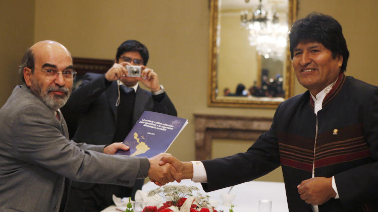 Bolivia's President Evo Morales, right, shakes hands with Jose Graziano da Silva of Brazil, director-general of the UN Food and Agriculture Organization (FAO), during a meeting at the government Palace in La Paz, Bolivia, Thursday Sept. 15, 2011. (AP Photo/Juan Karita)