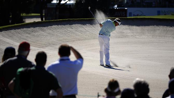 Davis Love III hits out of the bunker on the ninth fairway during the first round of the McGladrey Classic golf tournament Thursday, Oct. 23, 2014, in St. Simons Island, Ga. (AP Photo/Stephen B. Morton)