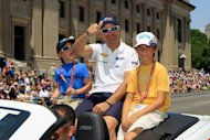 Formula One veteran Rubens Barrichello waves to fans during the Indianapolis 500 Festival Parade on May 26. Barrichello pronounced himself satisfied with his Indianapolis 500 debut after finishing 11th in the 96th running of the US racing spectacle