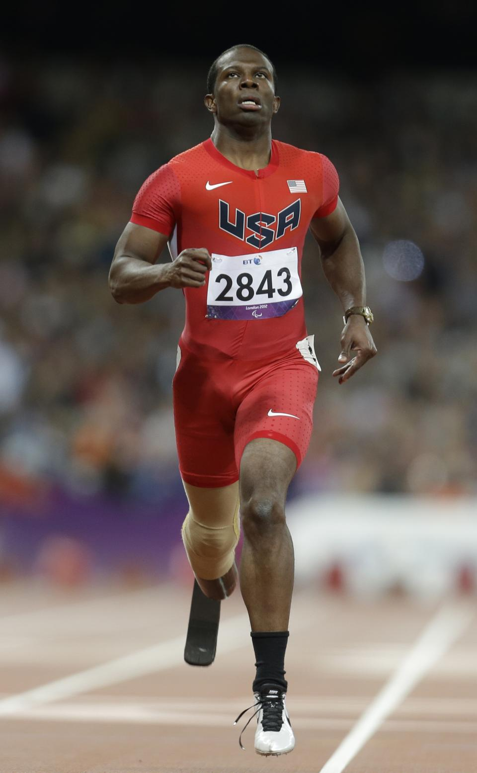United States' Jerome Singleton competes at a men's 200m T44 round 1 race at the 2012 Paralympics in London, Saturday, Sept. 1, 2012. (AP Photo/Lefteris Pitarakis)