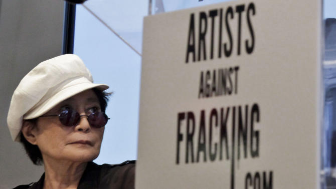 """FILE- In this Aug. 29, 2012 file photo, Yoko Ono appears at a news conference in New York to launch the coalition of artists opposing hydraulic fracturing.  Ono and her son, Sean Lennon, formed a group called """"Artists Against Fracking,"""" which has become the main celebrity driven anti-fracking organization.  (AP Photo/Bebeto Matthews, File)"""