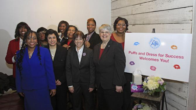 """IMAGE DISTRIBUTED FOR PUFFS - Dress for Success women pose after receiving makeovers during the Puffs Tissues 'Kisses"""" event on Tuesday, Feb. 12, 2013 at High Five Salon in Cincinnati, Ohio, home of Proctor & Gamble. (Skip Peterson/AP Images for Puffs)"""