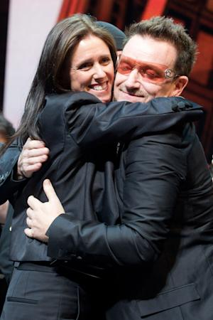 """Julie Taymor and Bono appear onstage at the curtain call for the opening night performance of the Broadway musical """"Spider-Man: Turn Off the Dark"""" in New York, Tuesday, June 14, 2011. (AP Photo/Charles Sykes)"""