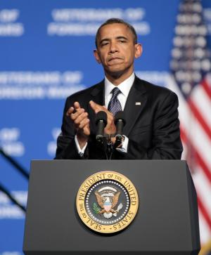 President Barack Obama leads a round of applause for veterans of the Vietnam war during his speech at the 113th National Convention of the Veterans of Foreign Wars in Reno, Nev. Monday, July 23, 2012. (AP Photo/Rich Pedroncelli)