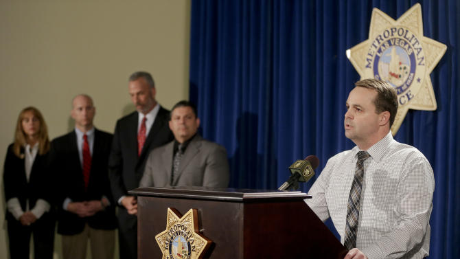 Las Vegas Metro Police Capt. Chris Jones, talks during a news conference, Thursday, Feb. 28, 2013, in Las Vegas. Jones talked about the arrest of Ammar Harris, 26, a self-described pimp who was captured Thursday in Los Angeles, ending a manhunt that began after a vehicle-to-vehicle shooting and spectacular, fiery crash that killed three people on the Las Vegas Strip a week ago.  (AP Photo/Julie Jacobson)