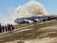 Passengers evacuate the Asiana Airlines Boeing 777 aircraft after a crash landing at San Francisco International Airport in California July 6, 2013 in this handout photo provided by passenger Eugene Anthony Rah released to Reuters on July 8, 2013. REUTERS/Eugene Anthony Rah/Handout via Reuters/Files