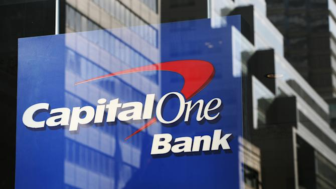 FILE - In this April 25, 2008 file photo, New York buildings are reflected in the window of a Capital One bank branch window. Capital One Financial Corp. said Wednesday, Aug. 10, 2011, that it will buy the U.S. credit card arm of Britain's HSBC for a premium of about $2.6 billion as a way to expand its domestic credit card business. (AP Photo/Mark Lennihan, File)