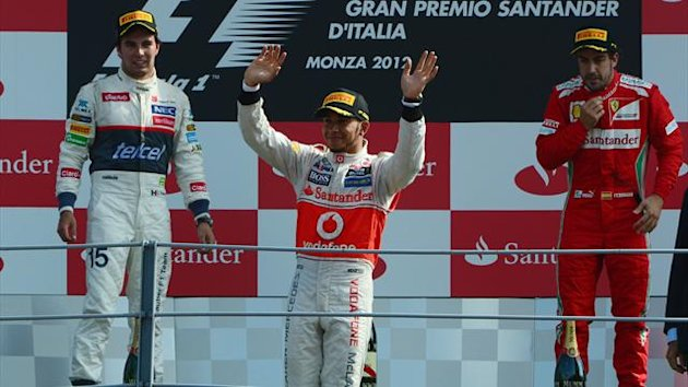 Sauber's Mexican driver Sergio Perez, McLaren Mercedes' British driver Lewis Hamilton and Ferrari's Spanish driver Fernando Alonso celebrate on the podium at the Autodromo Nazionale circuit on September 9, 2012 in Monza after the Italian GP (AFP)