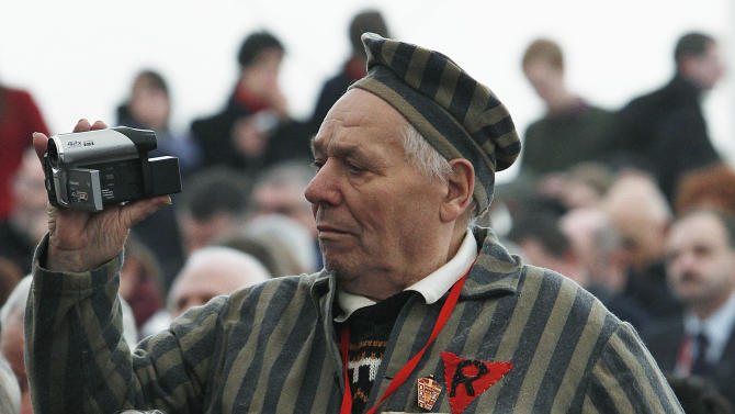 A former prisoner of the Auschwitz concentration camp  films the celebrations  in Oswiecim, Poland, Sunday, Jan. 27, 2013,  marking the 68th anniversary of the liberation of Auschwitz by Soviet troops and  remembering  the victims of the Holocaust, in Auschwitz-Birkenau.  (AP Photo/Czarek Sokolowski)